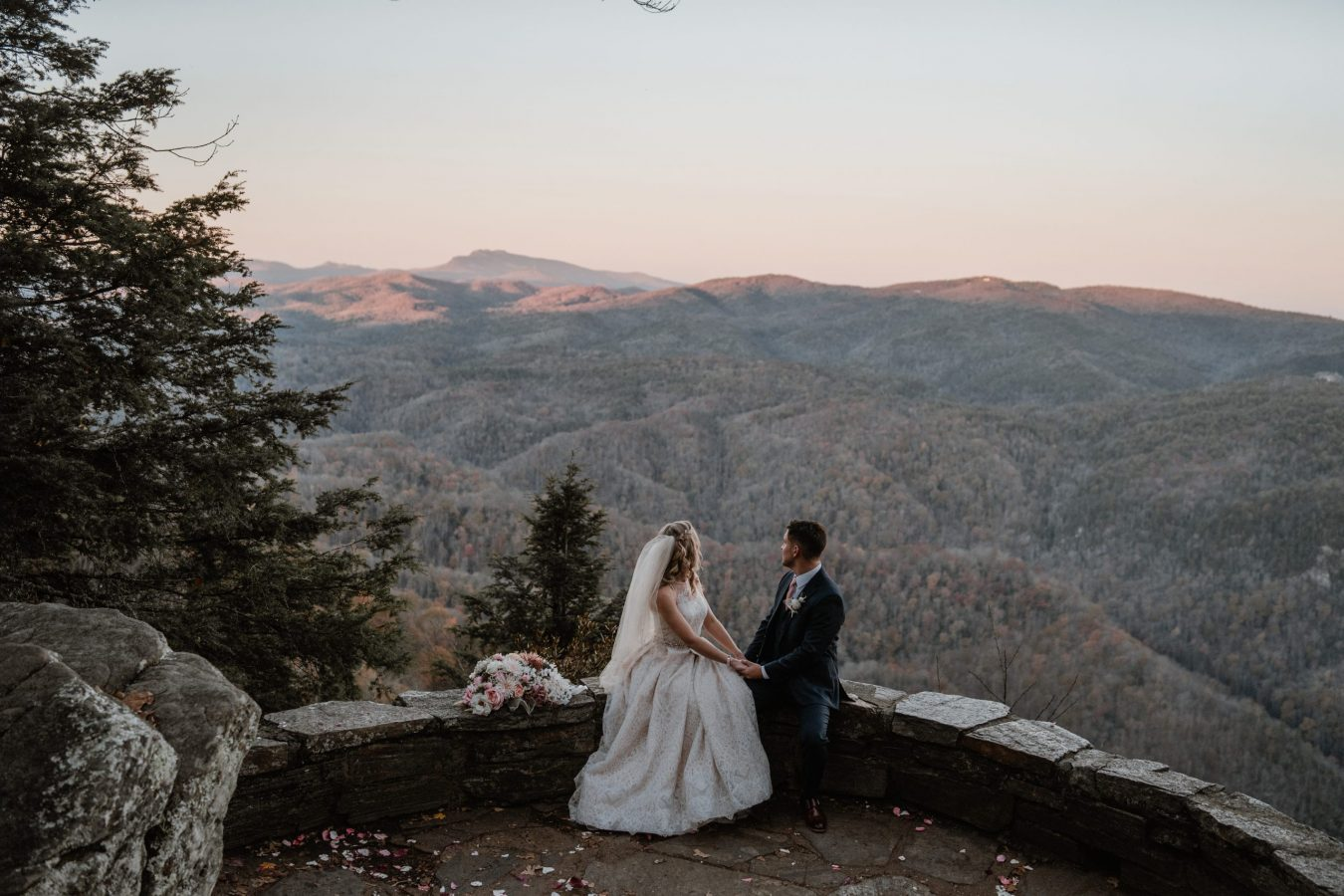 bride and groom looking out at linville gorge