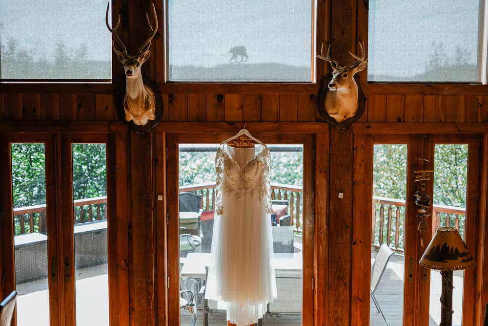 Dress hanging in the window for this Boone NC elopement