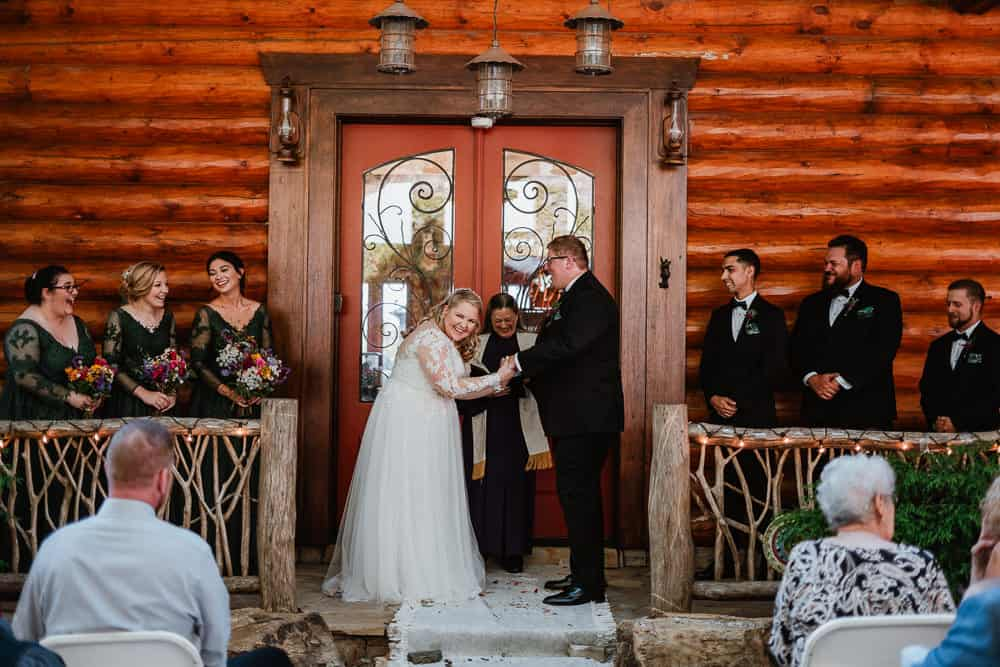 A bride and groom saying their vows in front of their airbnb wedding venue