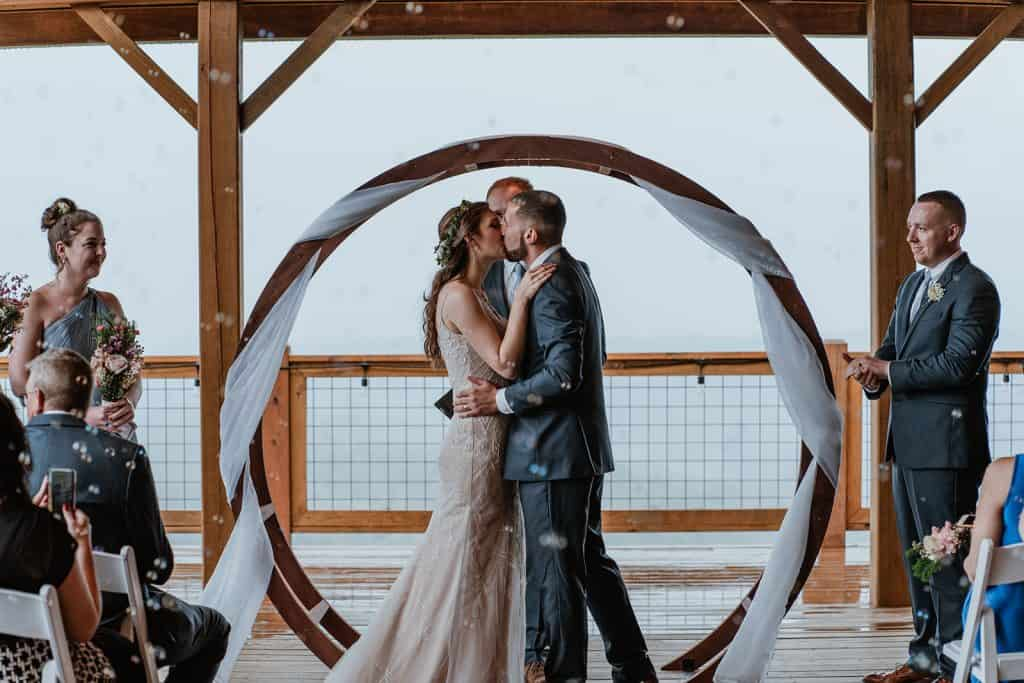 A couples' first kiss during their ceremony