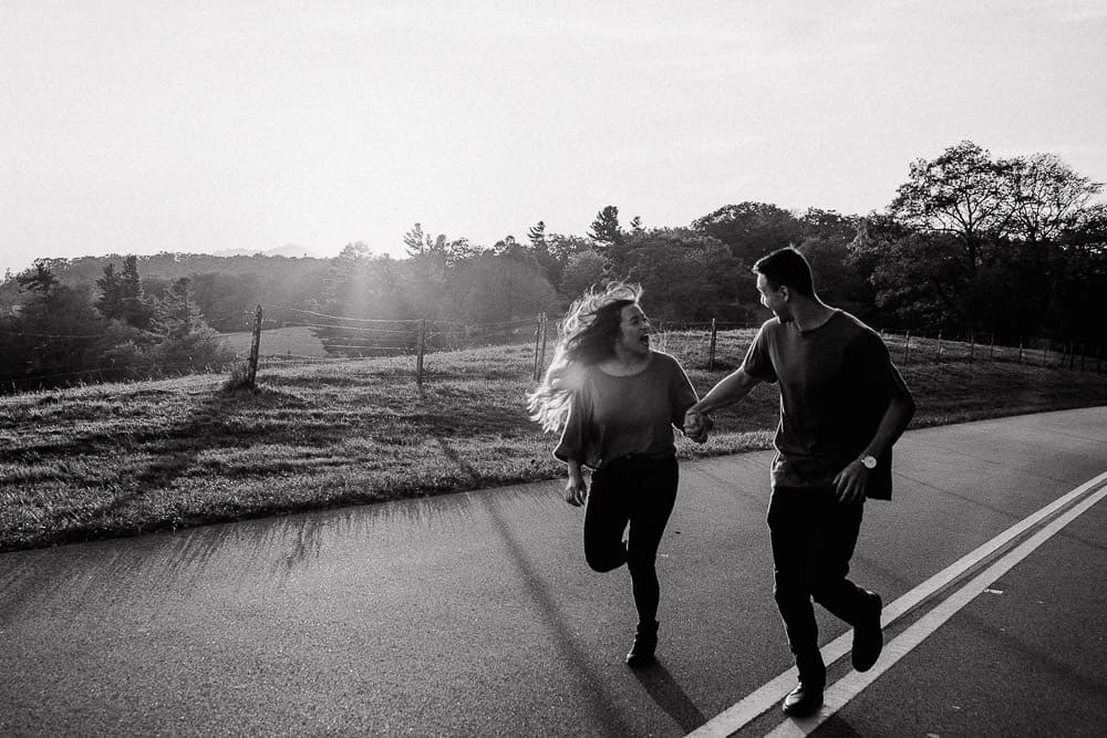 couple running down the Blue Ridge Parkway in Boone nc